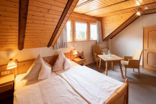 Gästehaus Cloef Bett und Sitzecke